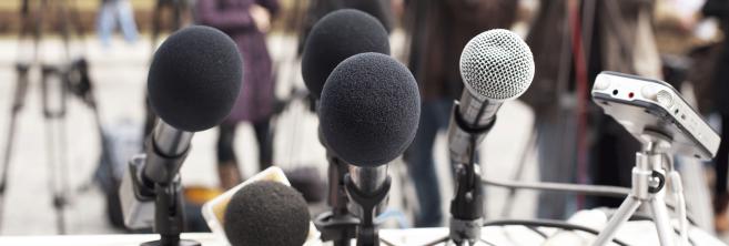 microphones-on-podium