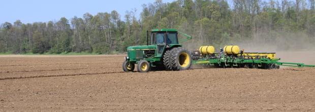 tractor-pulling-farming-equipment-across-field